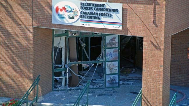 Scene after an explosion at a Canadian Forces recruiting centre in Trois-Rivieres, Que., July 2, 2010