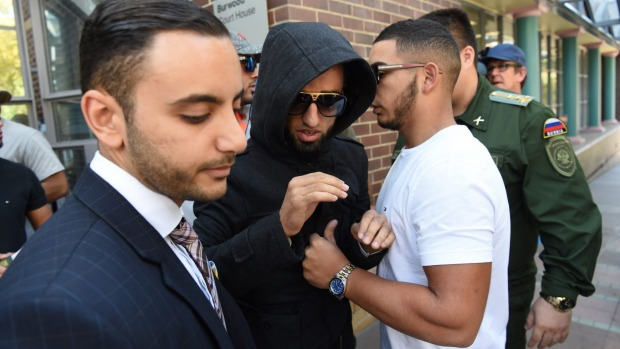 Muhammad Ibrahim leaves court with his lawyer