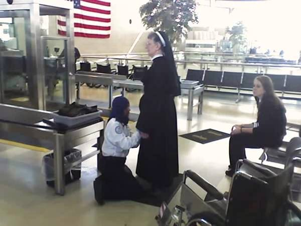 Airport security (Detroit Metro Concourse A). An elderly Catholic nun being frisked by a Muslim security agent