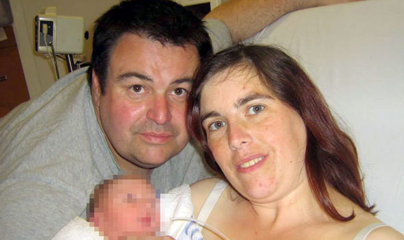 David Hinton and his wife Nadine and infant