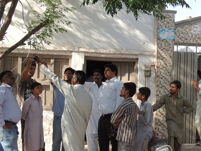 Neighbors point to the tree from which the Christian boy was lynched