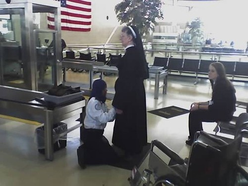 Nun being body-searched by Muslim TSA agent