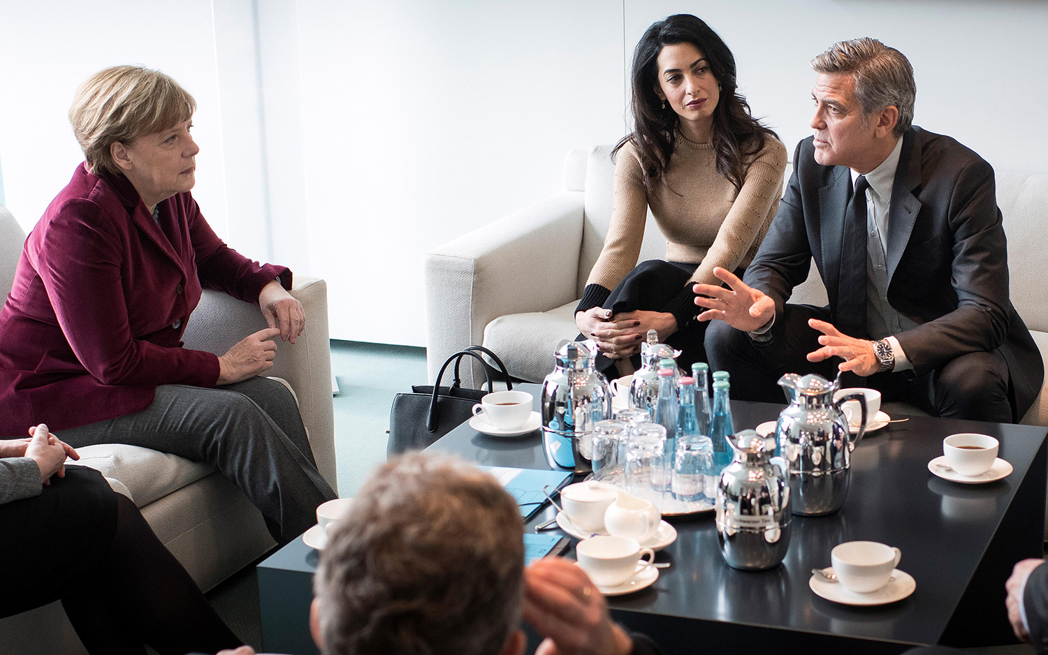 "Angela Merkel told reporters that she had had ""a very good conversation"" with the Clooneys, exchanging ideas for how aid groups and governments can co-operate to encourage citizens to volunteer to help Muslim refugees"
