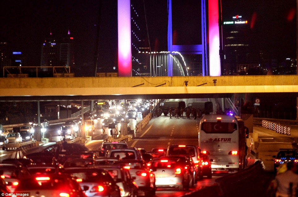 3652773300000578-3692693-Soldiers_blocked_Istanbul_s_Bosphorus_Bridge_which_was_lit_in_th-a-94_1468615344648