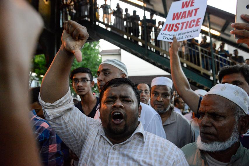 Muslim gather for a demonstration near a crime scene where 55-year-old Imam Maulama Akonjee and his 64-year-old associate, Tharam Uddin, were shot in the back of the head left the Al-Furqan Jame Masjid mosque in the Ozone Park section of Queens in New York City on Aug. 13, 2016