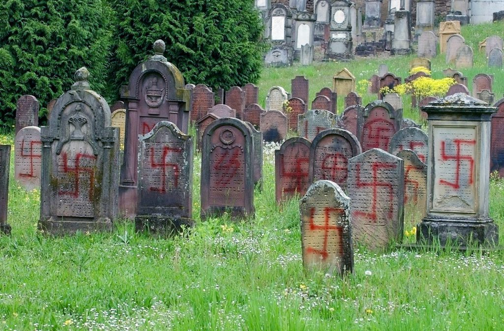 Swastikas and other Nazi symbols are seen on headstones at a Jewish cemetery in Herrlisheim, eastern France