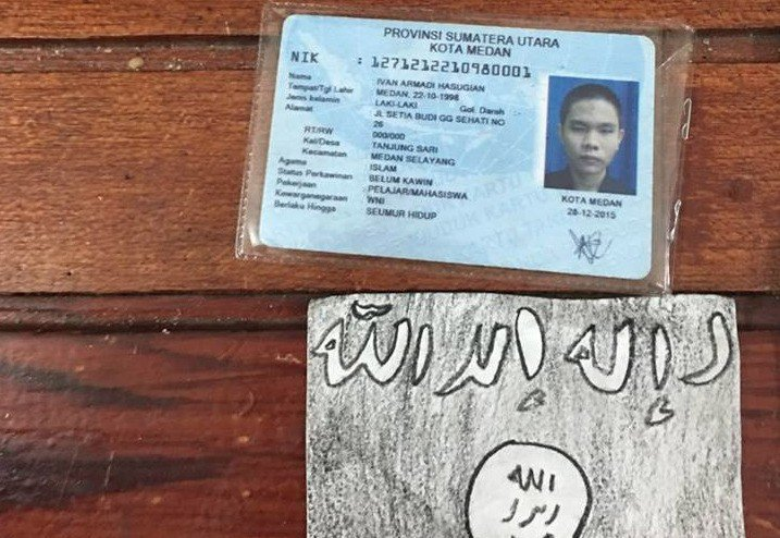 An ID and piece of paper featuring the Islamic State symbol confiscated by Medan Police from attacker