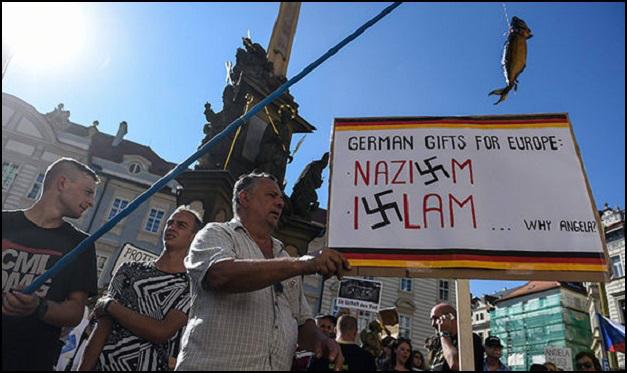 germany-angela-merkel-protestors-in-prague