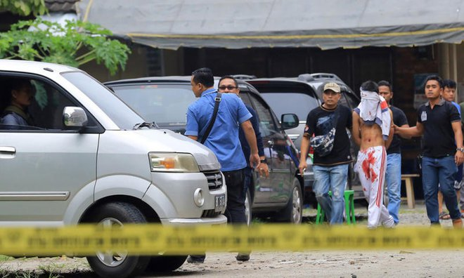 Indonesian police arrest blindfolded suspect