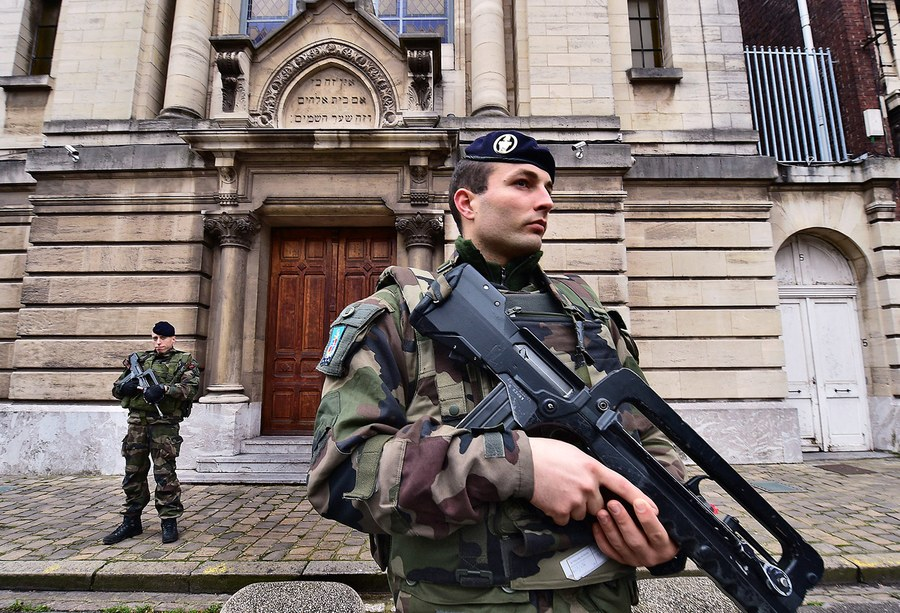 A French soldier stands guard at a synagogue in Lille, France