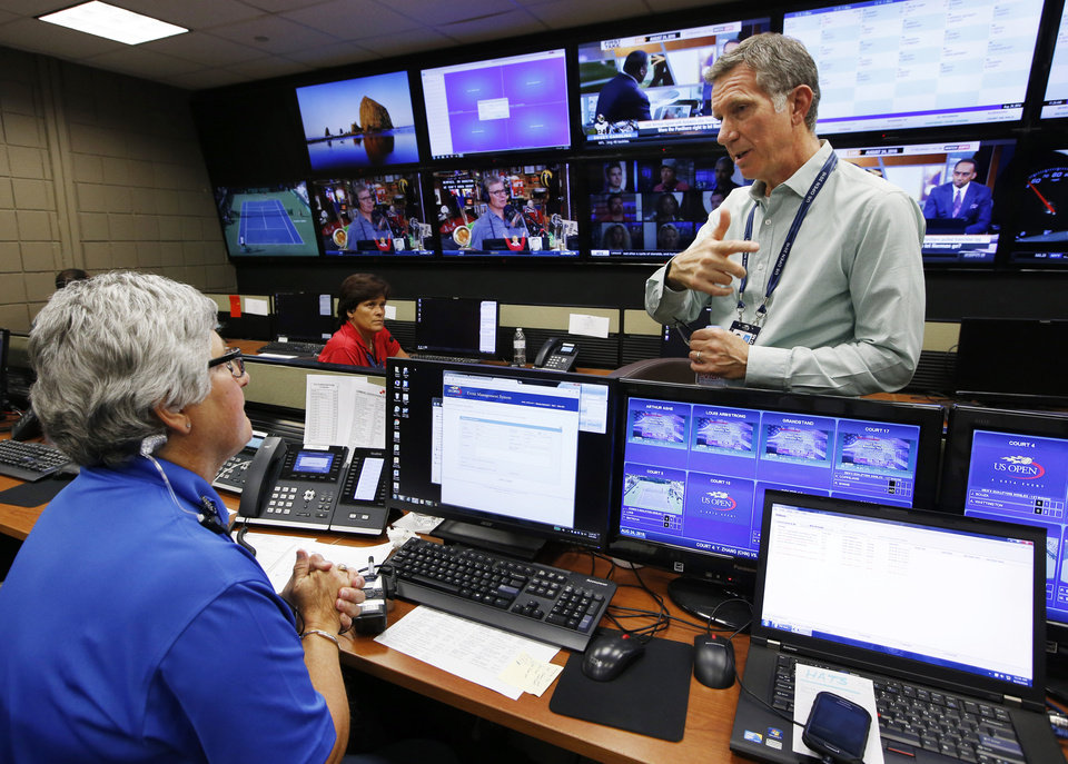 U.S. Open Tennis Tournament Security Director Michael Rodriguez talks with a worker at the tournament's command center,