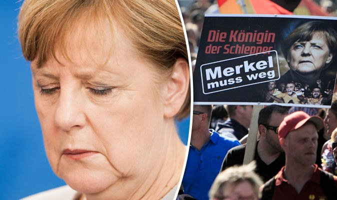 Sign says 'Merkel Must Go'