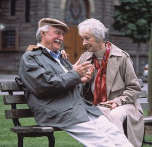 older_couple_sitting_in_a_park