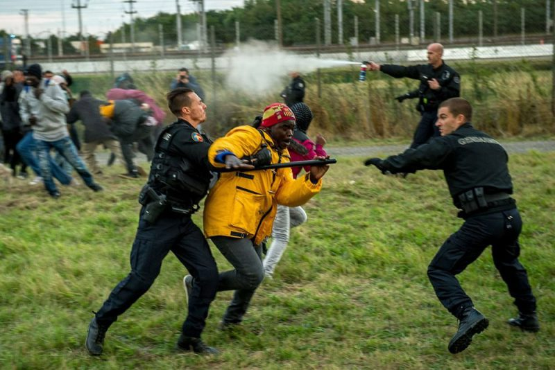 Hungarian police spraying the vermin and/or arresting them
